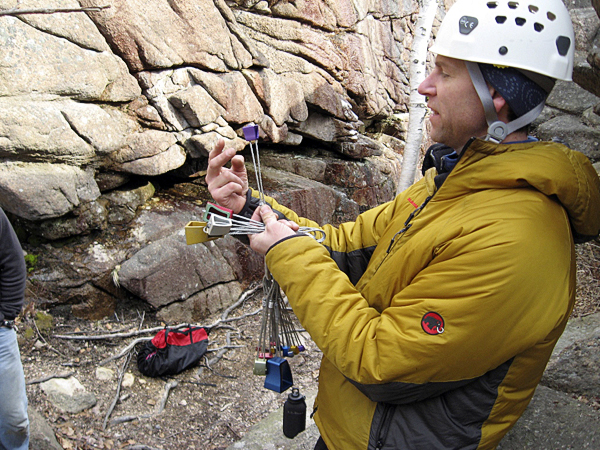 Scott Fraser explains the placement of  chocks to the students for climbing protection.