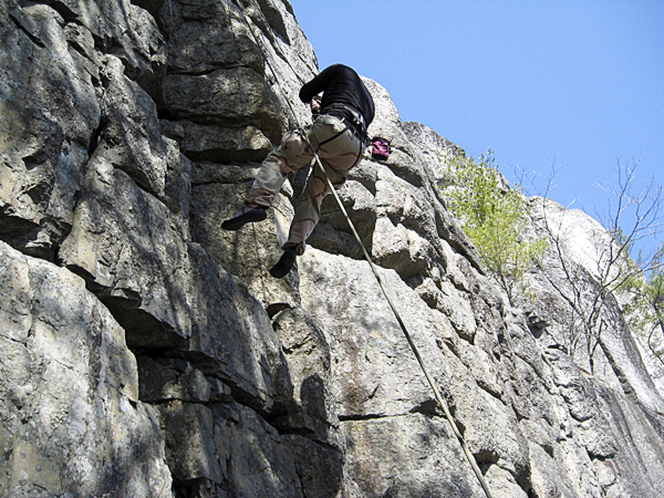 Nathan Hammick, another first year student, rappels off the cliff face at Eagle Bluff in Clifton.