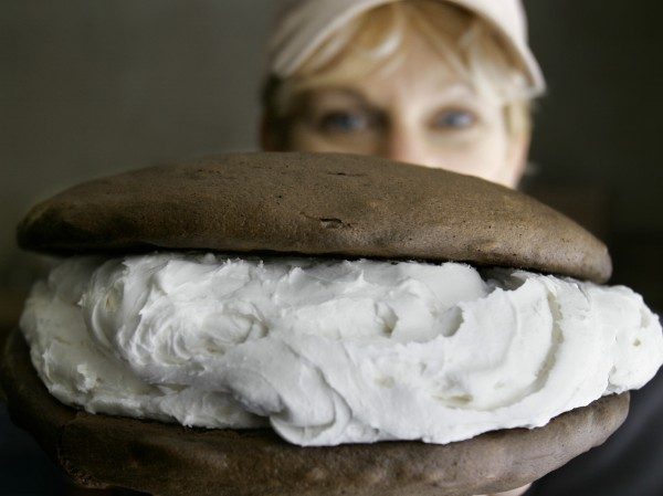 Baker Amy Bouchard holds up a jumbo whoopie pie at her Isamax Snacks factory in Richmond in December 2005. Bouchard cranks out 5,000 to 7,000 of the desserts per day. Whoopie pies will become Maine's official state treat. The whoopie pie is now Maine's official treat. A bill that also makes the blueberry pie Maine's official dessert became law on Wednesday.
