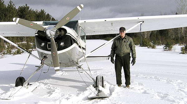 Daryl Gordon stands next to a plane ( not the plane in which he crashed) on a frozen lake.  Gordon, one of the agency's game wardens, was killed in the crash of a small plane on Clear Lake in a remote northern part of Piscataquis County Thursday night, March 2011.