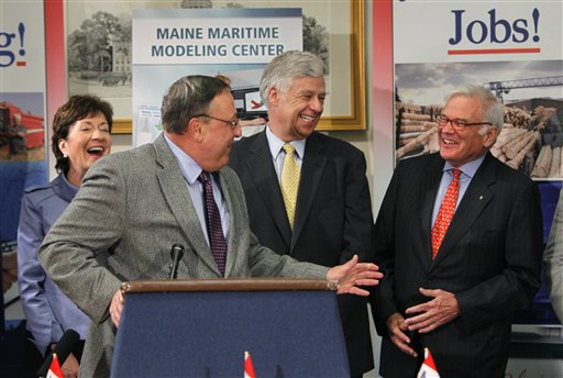 Gov. Paul LePage, at podium, jokes with Robert Somerville, chairman of American Bureau of Shipping, far right, during a news conference at the State House, Thursday, April 28, 2011, in Augusta, Maine. American Bureau of Shipping is planning to establish a computer-based ship modeling center at the former Brunswick Naval Station. U.S. Sen. Susan Collins, R-Maine, far left, and U.S. Rep. Michael Michaud, D-Maine, look on.