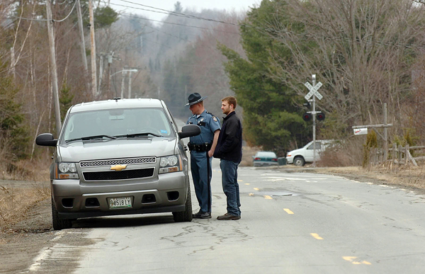 Law enforcement officers convene in front of a residence on Mill Street in LaGrange after receiving a false report of a female forcibly taken from a residence. When asked what was occurring, Maine State Trooper Scott Hamilton (inside the pictured vehicle) remarked, &quotA whole lot of nothing. No one's going to jail and the intoxicated parties are going back inside.&quot