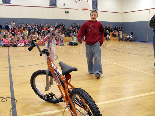 Jayden Maynard, 9, of Hartland, checks out the new bicycle he had just won Thursday from the Bikes for Books program, which is run by numerous Masonic groups in Maine. The Corinthian Masonic Lodge 95 in Hartland gave away 20 bikes Thursday at Hartland Consolidated School.