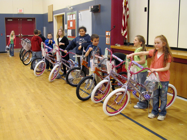Students from Hartland and St. Albans check out the bikes they won Thursday from the Bikes for Books program. Each book the students read was worth one chance at winning a bike.