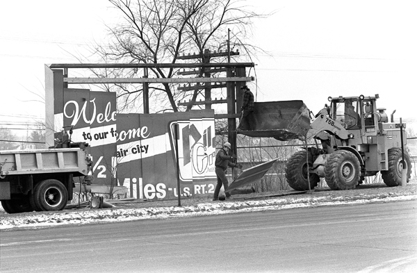 A billboard on Main Street in Bangor was torn down in 1984 by Maine Department of Transportation workers. Maine billboard owners had until Jan. 1 of that year to tear down any remaining signs along roadways or have the state remove them and charge for its services. In 1979 Maine approved highway beautification legislation that began a phase-out of more than 2,000 billboards.