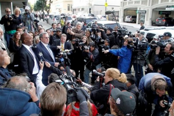 Barry Bonds, left, and his attorney Allen Ruby face the media outside a federal court building Wednesday, April 13, 2011, in San Francisco.