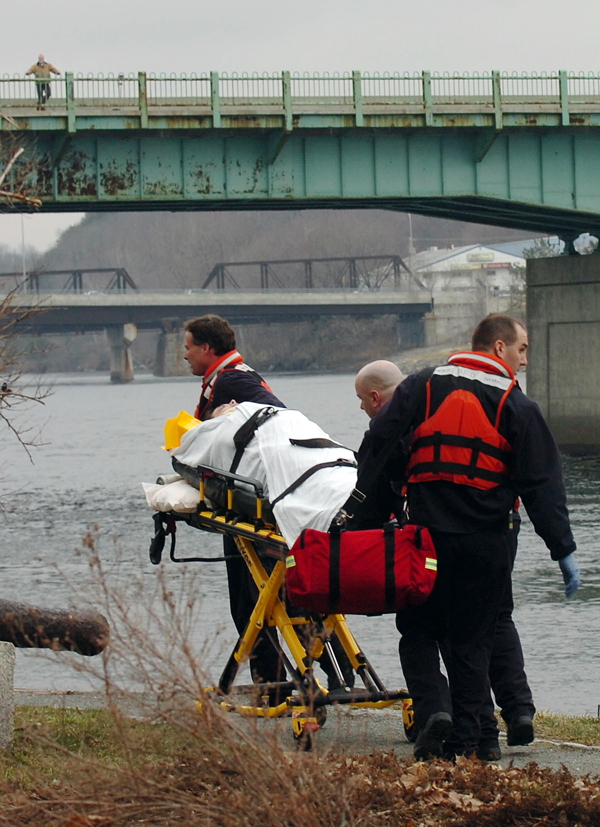 Emergency crews transport a woman who was pulled from the Penobscot River on the Bangor Waterfront after allegedly jumping from the Joshua Chamberlain Bridge.