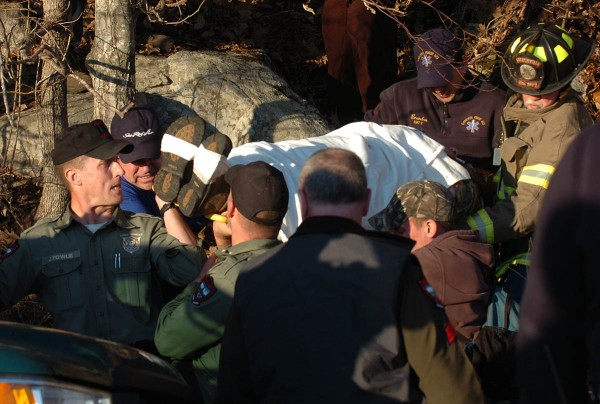 "Rescue crews carry down Charles ""Reed"" Black, of Camden, from Mt. Megunticook on Thursday, April 7, 2011. Earlier in the day, an injured woman, Black's wife, Lisa Black, made her way down the mountain, which lead law enforcement authorities to search for her husband. Officials have not immediately disclosed if a crime occured."