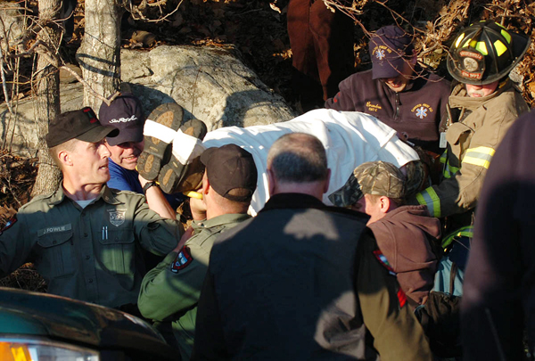 """Rescue crews carry down a man from Mt. Megunticook on Thursday, April 7, 2011. Police identified the man as Charles """"Reed"""" Black, 68, of Camden. Earlier in the day, an injured woman, Black's wife, Lisa, 52, made her way down the mountain, which lead law enforcement authorities to search for her husband. Officials have not immediately disclosed if a crime occurred."""