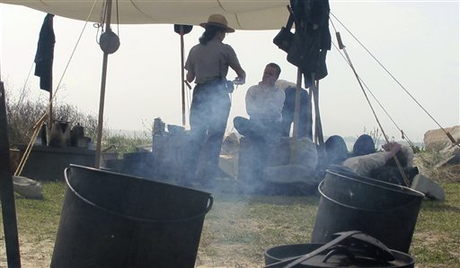 Union re-enactors  outside Fort Sumter, S.C., speak with a National Park Service ranger Monday, April 11.