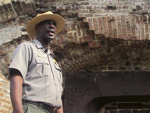 Michael Allen, a Fort Sumter ranger, speaks with reporters  Monday, April 11.