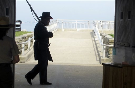 A Union re-enactor stands guard at the gate of Fort Sumter in Charleston, S.C.,  Harbor on Monday, April 11.