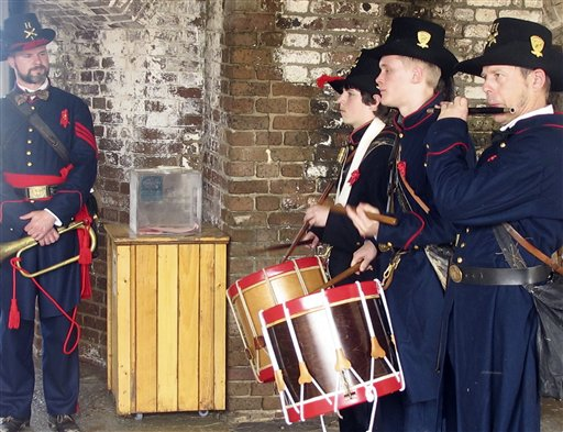 Union re-enactors play inside the gate of Fort Sumter in Charleston, S.C.,  Harbor on Monday, April 11.