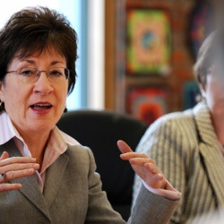 Senator Susan Collins asks a question of the staff at the Eastern Maine Development Center in Bangor during a visit on Wednesday.
