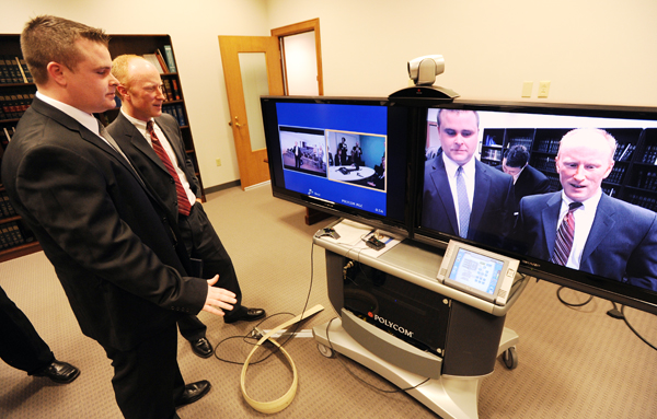 Immigration Customs Enforcement Special Agent Patrick Flaherty, left and Asst. US Attorney Todd Lowell offer congratulations and thanks to their counterparts in West Midlands England via teleconference in the  June 2009 Julie Carr child pornography case  at the US Attorney office in Bangor on Thursday.