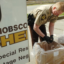 "Chief Troy Morton of the Penobscot County Sheriff's Department discards unused prescription medications as part of the National Take-Back Day on Saturday, April 30, 2011, at Bangor's Cascade Park. Coordinated by the U.S. Drug Enforcement Administration, the program offers the opportunity to safely disgard of unused or unwanted prescription drugs, which will then be incinerated. Due to the convenient location, Morton received a steady flow of drop-offs throughout the morning. ""It's like a McDonald's drive-through,"" Morton said, ""you can just pull in and out."""