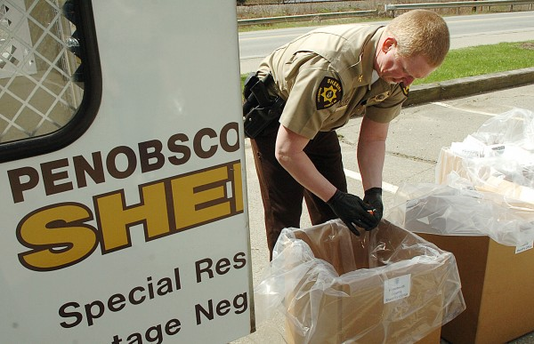 Chief Troy Morton of the Penobscot County Sheriff's Department discards unused prescription medications as part of the National Take-Back Day on Saturday, April 30, 2011, at Bangor's Cascade Park. Coordinated by the U.S. Drug Enforcement Administration, the program offers the opportunity to safely disgard of unused or unwanted prescription drugs, which will then be incinerated. Due to the convenient location, Morton received a steady flow of drop-offs throughout the morning. &quotIt's like a McDonald's drive-through,&quot Morton said, &quotyou can just pull in and out.&quot
