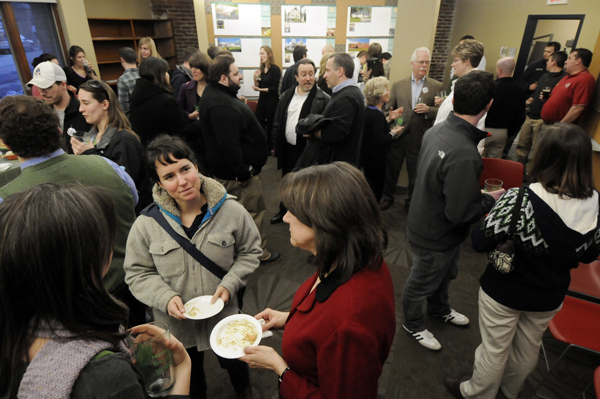 In foreground: Meaghan LaSala (center), of Bangor, catches up with Laura Binger (left), of Brewer and Elizabeth Stevens (right), of Bangor during the Bangor's Greendrinks gathering at the offices of WBRC Architects-Engineers in downtown Bangor in March.  The recently-started Bangor Greendrinks movement joins a worldwide network of other Greendrinks informal social networking events which are geared toward enviromental and sustainable values.