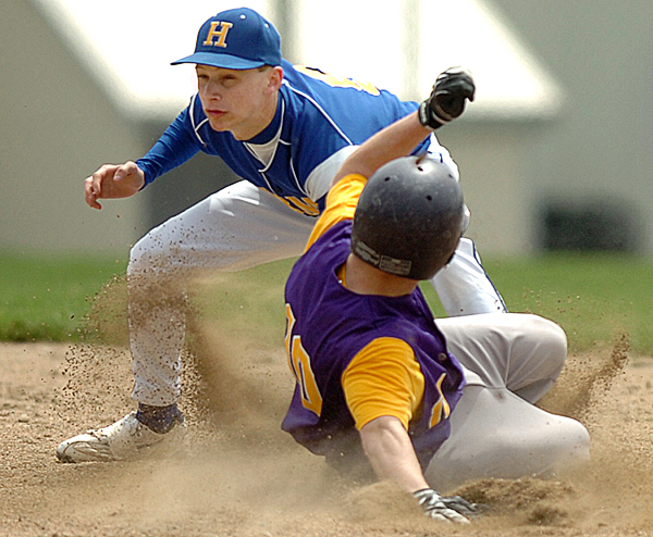 Hermon shortstop Reid McGinley outs Bucksport's Tyler French as he slides into second base in the top of the third inning as Hermon hosted Bucksport on Saturday.