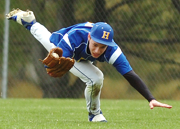 Hermon's Tyler Fournier dives to catch a fly ball as Hermon hosted Bucksport on Saturday.