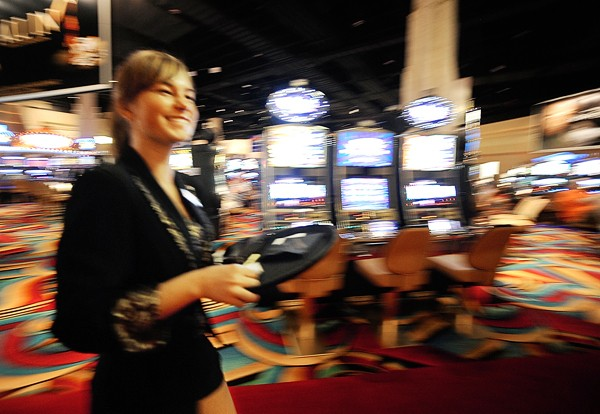 Beverage server Erika Martin of Orono makes her rounds past the slot machines at Hollywood Slots in Bangor in this 2010 file photo. Lawmakers will consider a bill that would allow Hollywood Slots to add table games.