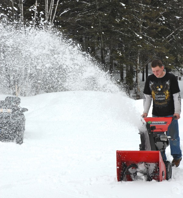 On April 21, Kenny Lebel of St. Agatha clears a path at a home in Fort Kent through what is widely hoped to be the final snowfall of the season. Wednesday's 5.9 inches in Caribou broke the old record of 3.3 inches for April 20 set in 1978.