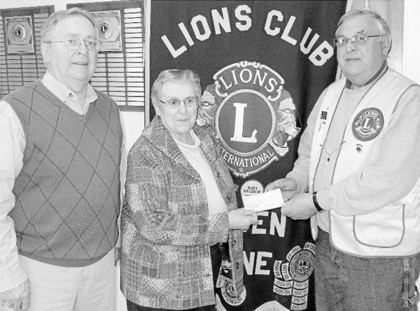 Camden Lions Club president Frank Carr (right) presents Lois Stackpole Alley, Meals on Wheels representative, a check for $500. John McKay, club secretary, looks on.