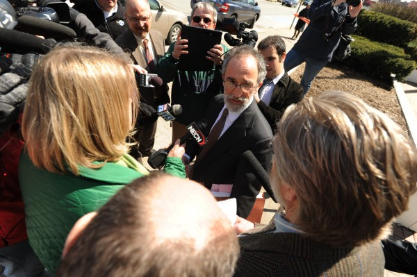 Deputy State Attorney General Peter Stern addresses the media outside the Margaret Chase Smith Federal Building in Bangor on Tuesday after defending the state's position before U.S. District Judge John Woodcock regarding the removal of Judy Taylor's History of Maine Labor mural from the Department of Labor offices in Augusta.