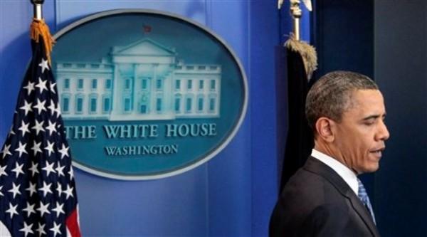 President Barack Obama walks to the podium to speaks to reporters at the White House in Washington Thursday, April 7.