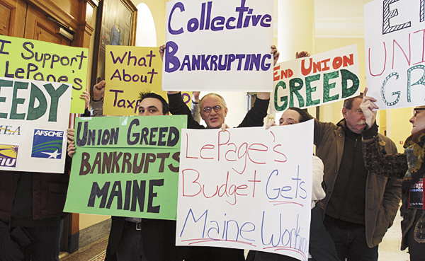 Proponents of Maine Gov. Paul LePage's proposals to change the pension system gathered in the Hall of Flags at the State House in Augusta on Wednesday.