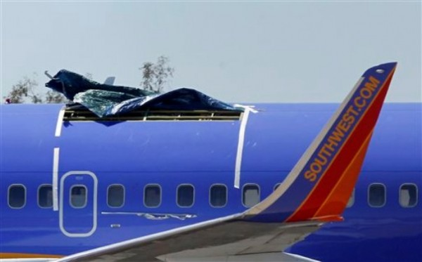 A Southwest Airlines plane sits in a remote area of the Yuma International Airport, after the plane had a section of fuselage tear from the plane during a flight on Friday, seen here Monday, April 4, 2011, in Yuma, Ariz.
