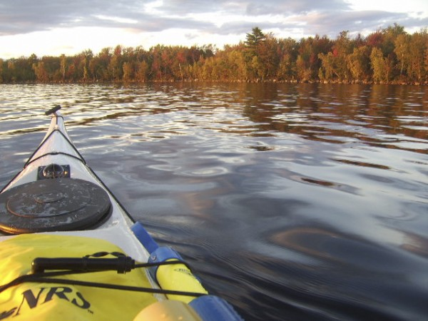 Some of the everyday safety gear every kayaker should take on an outing includes the yellow paddle float, a deck compass (forward of the black hatch cover) and a bilge pump.