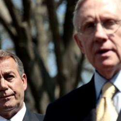 House Speaker John Boehner of Ohio listens at left, as Senate Majority Leader Harry Reid of Nev. speaks to reporters outside the White House in Washington, Thursday, April 7.