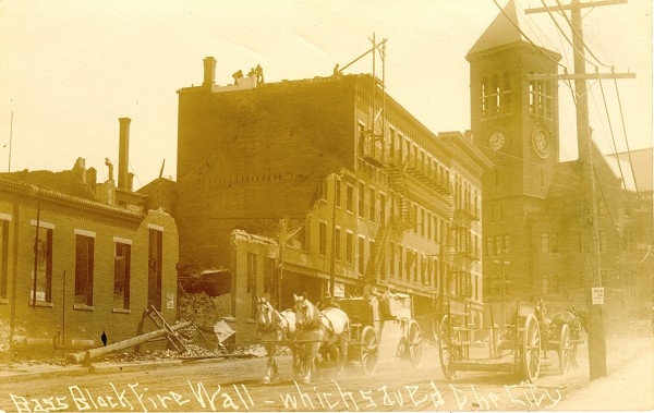 The brick wall at the back of the Bass building on Franklin Street was believed to have prevented the fire from jumping Hammond Street and destroying City Hall, seen in the distance.