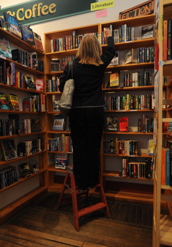 A customer searches for a book in the back of Rock City Books and Coffee in Rockland on Monday, April 11, 2011.