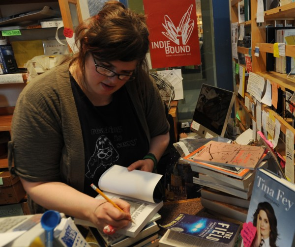 Lacy Simons sits at her desk in Rock City Books and Coffee on Monday, April 11, 2011. Simons has taken her plea for money to buy the bookstore that she has worked at since 2003 to the Internet and has experienced success as strangers have sent her donations to assist with the purchase.