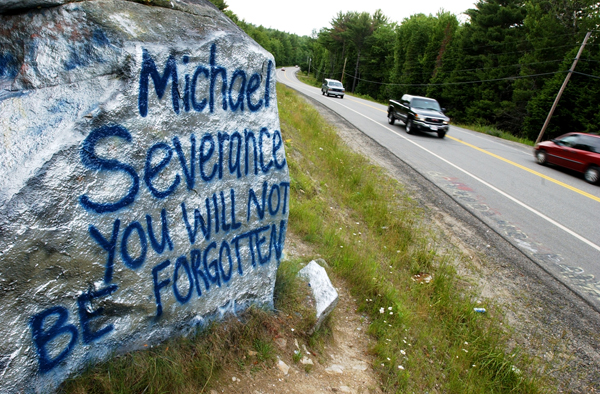 "In 2005 a large boulder served as the community bulletin board in Lincoln to honor murder victim Michael Leslie Severance. The opposite side reads, "" We love you ""Shane Michael""."