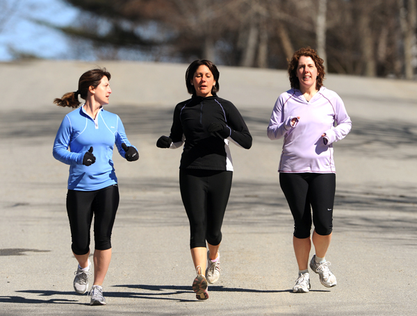 Christine Lally Kendall, left, of Bangor, Jennifer McGoldrick, center, of Bangor,and Amy Sidell,right, of Hampden, all part of a group that calls themselves the Sole Sisters run along Norfork Street in Bangor on Thursday. The women are training for the Sugarloaf marathon in May of this year.