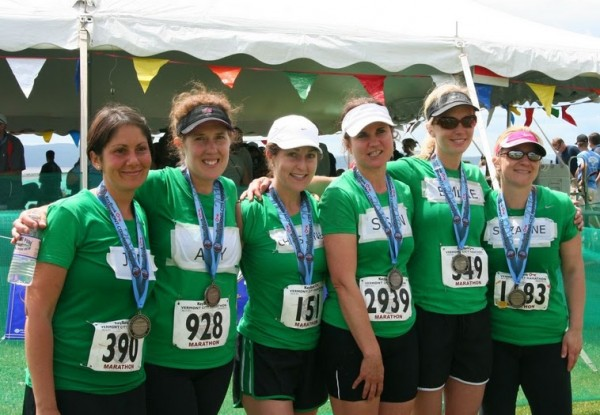 """Sole Sisters"" Jennifer McGoldrick, Amy Sidell, Christine Lally Kendall, Susan Thibedeau, Emlie Manhart and Suzanne Carver stand at the finish line of the 2010 Vermont City Marathon."