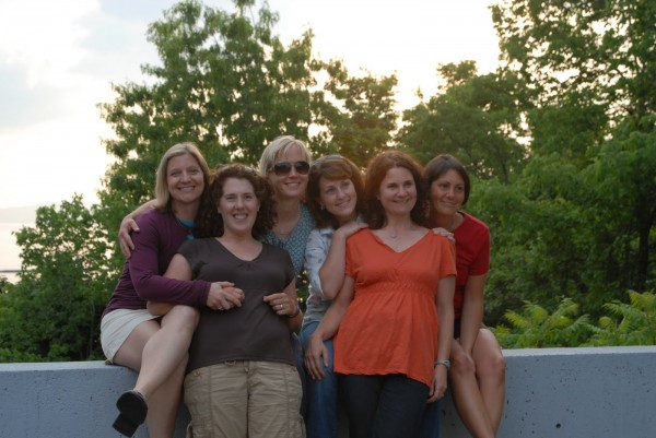 "The informal running group of Bangor area moms, the ""Soul Sisters,"" spend time together the evening before the 2010 Vermont City Marathon. Suzanne Carver (from left) hugs Amy Sidell, standing beside Emilie Manhart, Christine Lally Kendall, Susan Thibedeau and Jennifer McGoldrick."