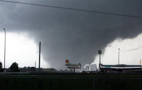 A tornado moves through Tuscaloosa, Ala. Wednesday. A wave of severe storms laced with tornadoes strafed the South on Wednesday, killing at least 16 people around the region.