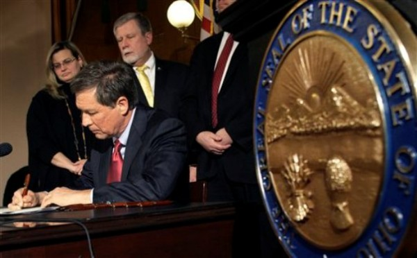 Ohio Gov. John Kasich in March signed into law a limit on the collective bargaining rights of 350,000 public workers, defying Democrats and other opponents of the measure who have promised to push for repeal.