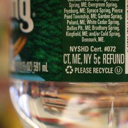 A spring water bottle label, noting a 5-cent refund, is seen Friday, Feb. 11, 2011 in Kittery, Maine.