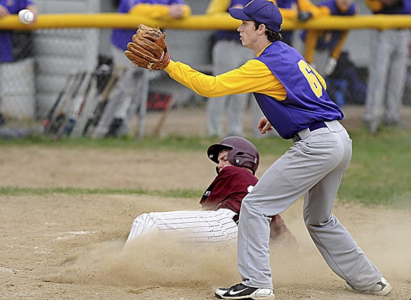George Stevens Academy's Finn McMahon-Allwine slides safely home plate on a wild pitch as Bucksport High School pitcher Ryan Bailey waits for the late throw during the third inning in Bucksport Tuesday afternoon. Bucksport won 9-7.