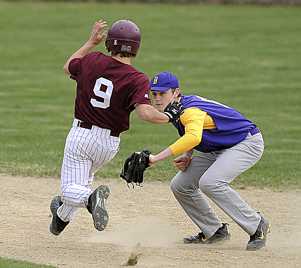 Bucksport High School's Evan Eldridge (right) gets ready to tag out George Stevens Academy's Josh Bowden at second base during the second in Bucksport Tuesday afternoon. The Bucks won 9-7.