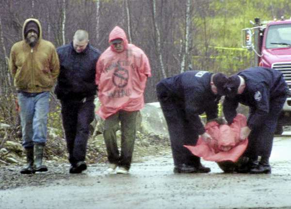 Three police officers take three protestors into custody at the $130 million Rollins Mountain industrial wind site off Route 6 in Lincoln in Nov. 2010.