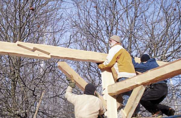 Timber framer and hewer Mike Beaudry of Montville constructs a roof frame using traditional joinery techniques.