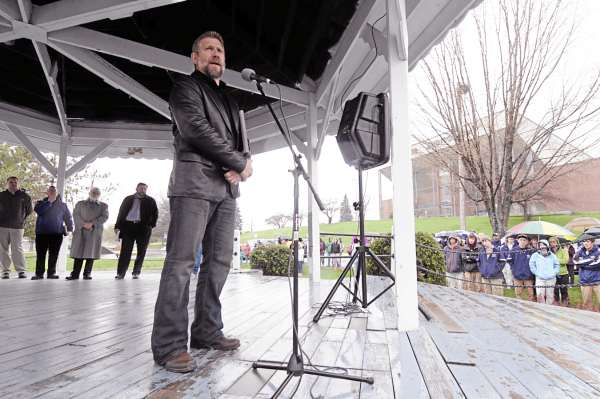 "Ken Graves (foreground), senior pastor at Calvary Chapel in Orrington, joined area clergy and several hundred other worshippers for the National Day of Prayer event at the Bass Park gazebo in Bangor Thursday afternoon.  This long-time annual observance, ordained by Congress in 1952, was established to allow citizens to ""turn to God in prayer and meditation."""