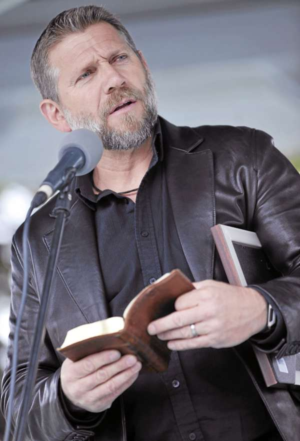 """Ken Graves, senior pastor at Calvary Chapel in Orrington, joined area clergy and several hundred other worshippers for the National Day of Prayer event at the Bass Park gazebo in Bangor Thursday afternoon.  This long-time annual observance, ordained by Congress in 1952, was established to allow citizens to """"turn to God in prayer and meditation."""""""