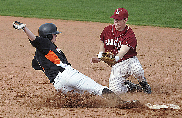 Bangor shortstop Jack Stacey tries to tag out Brunswick's Alex Emery on a pickoff attempt at second base during second-inning action Friday at Mansfield Stadium in Bangor. Emery was safe on the play. Bangor beat Brunswick 4-3 in eight innings.